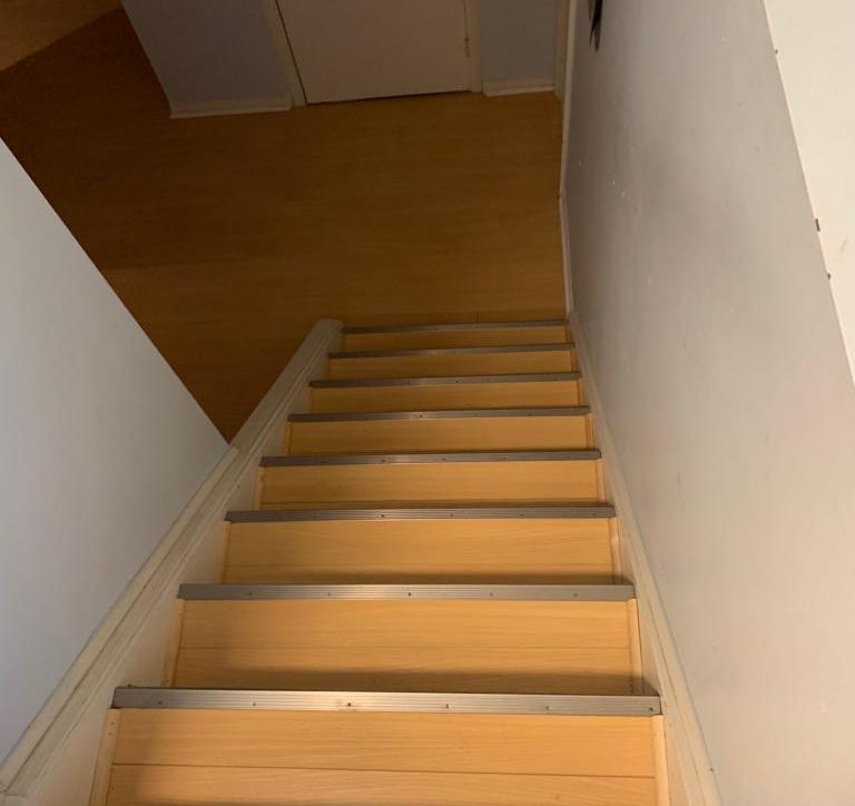 Staircase with no carpet after we removed it
