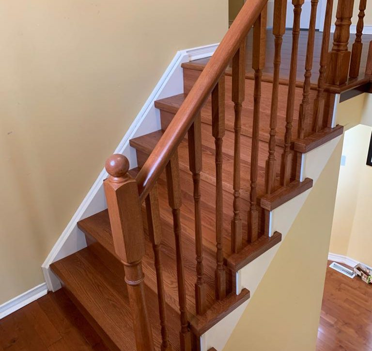 Finished product of the new stained hardwood staircase, second level