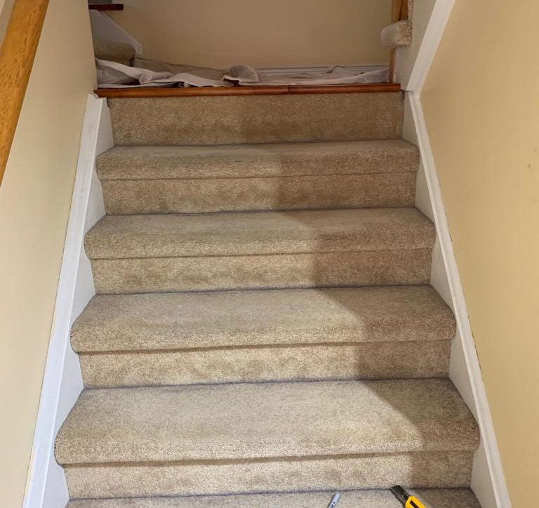 Starting the project, the staircase has carpet on it
